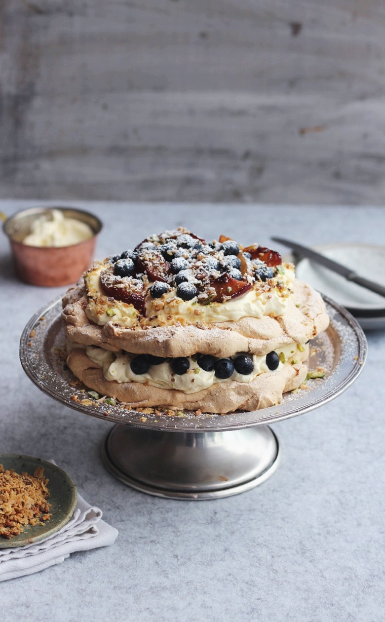 Cardamom Pistachio Sugar Pavlova with Peaches, Blueberries + Oat Crumble fingerforkknife.com